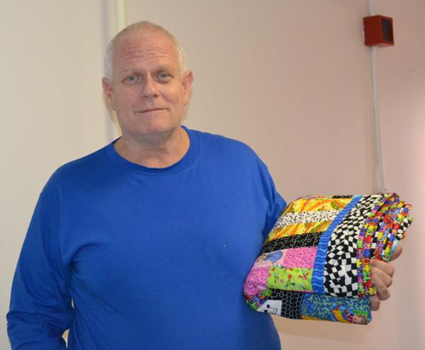 man-holding-quilt